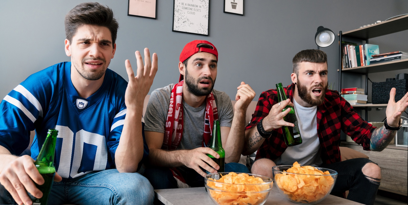 A photo of guys watching a game